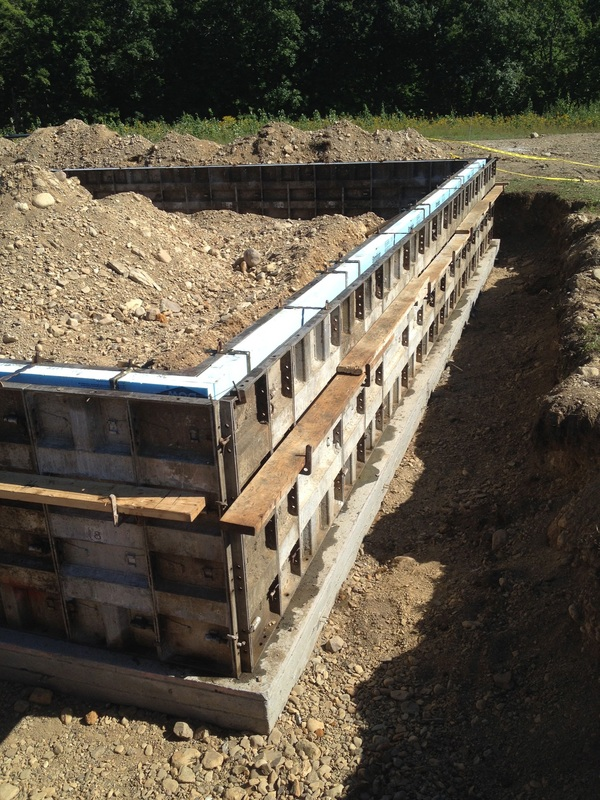 Day 2 foundation frost wall forms xps foam board for Basement wall forms